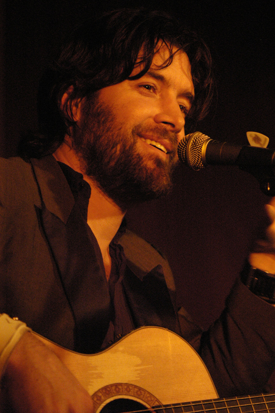 Bob Schneider playing guitar live